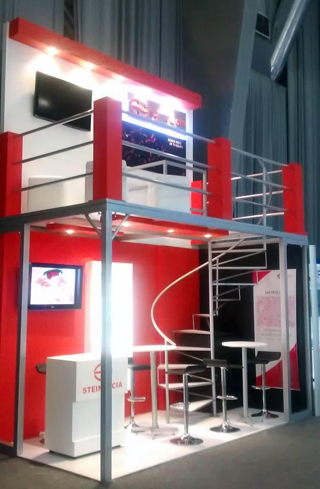 lindo stand feria mezzanine dos pisos escenorafía calidad diseño render  aencia diital finder publicidad